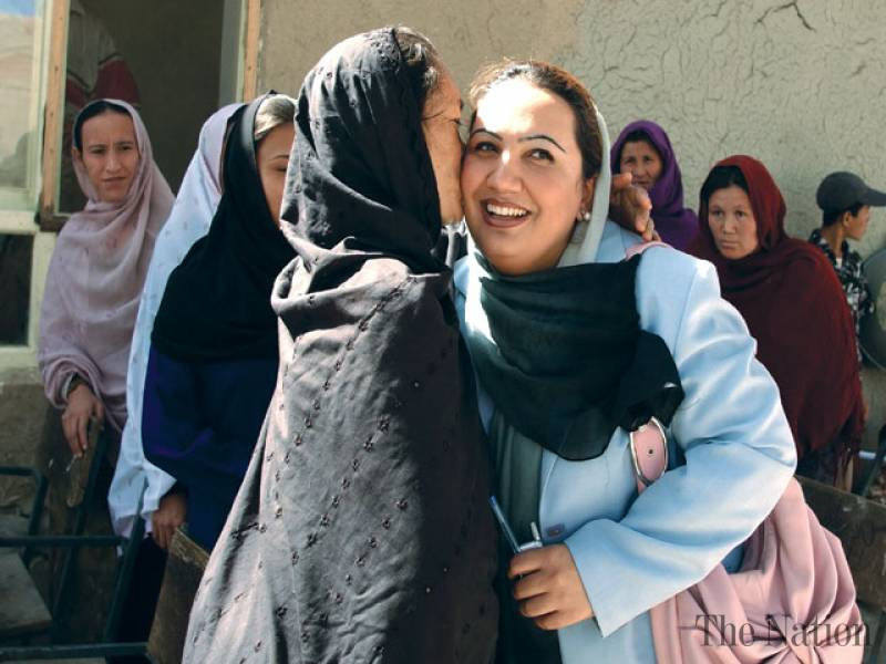 FEMALE AFGHAN MP SURVIVES SUICIDE ATTACK, THREE DEAD
